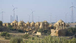 Wind turbines tower above cenotaphs built in memory of the maharajahs of Jaisalmer in Rajasthan.
